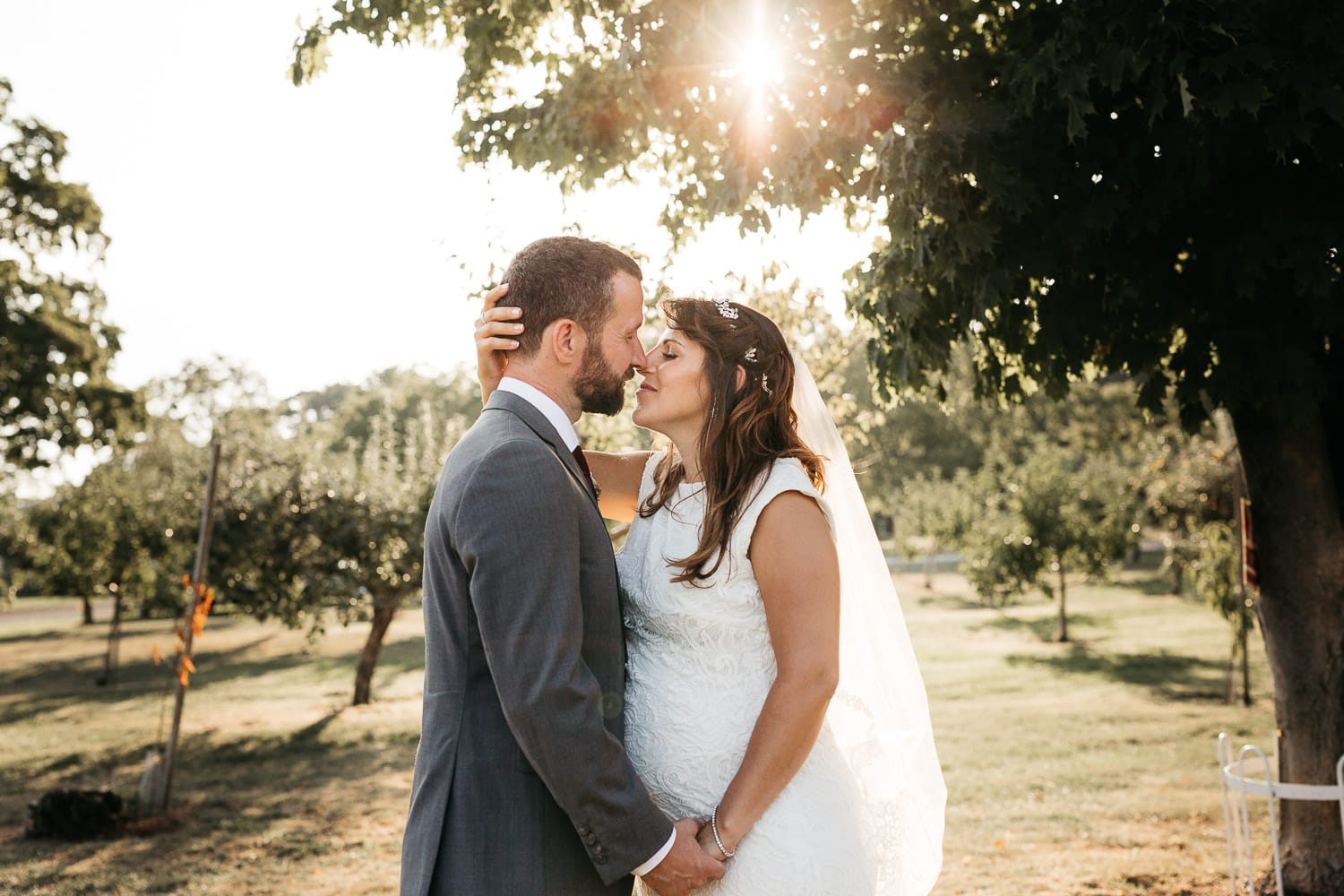 sunset kiss bride and groom at waupoos winery in Prince Edward county