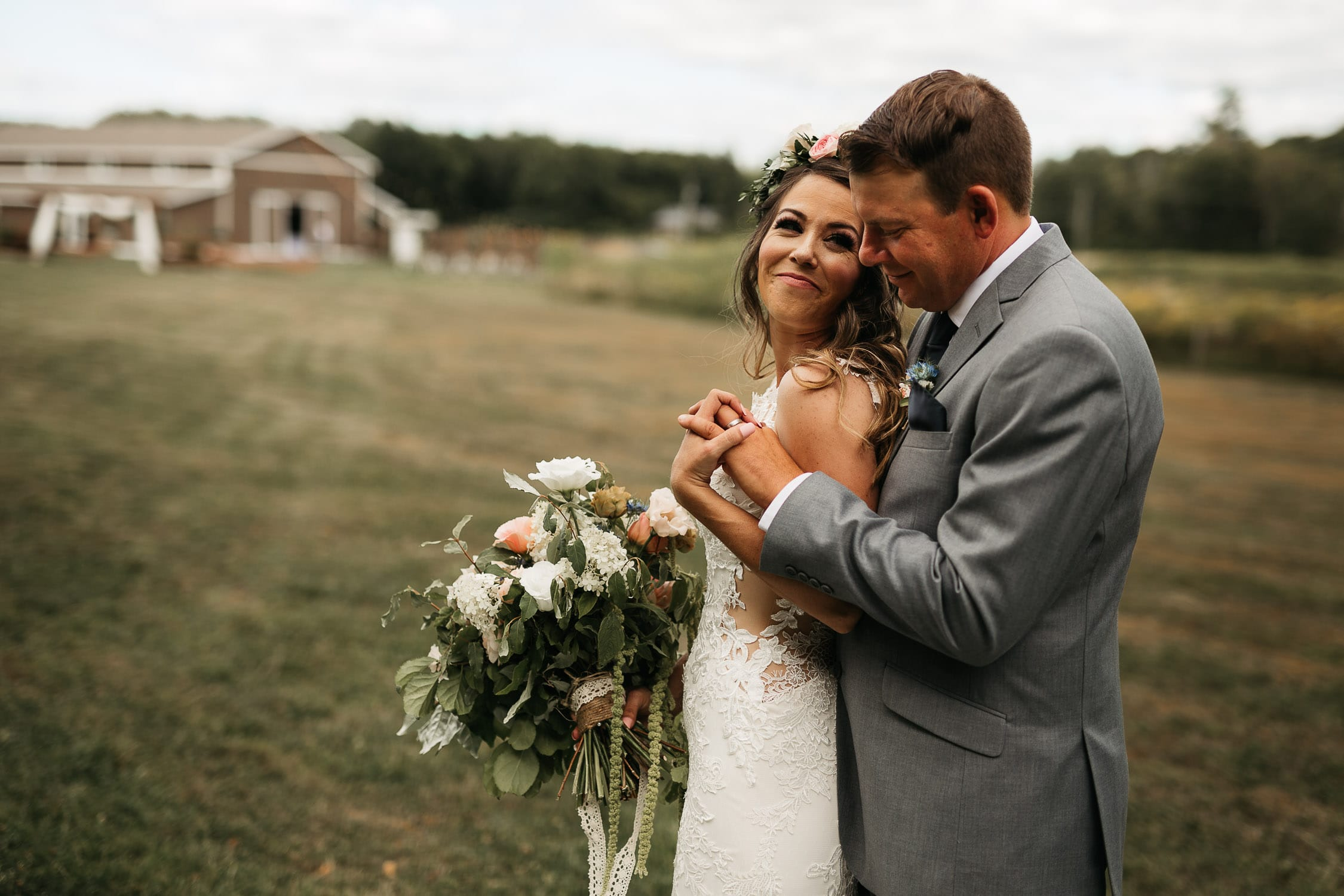 bride and groom snuggling at the meadows catering wedding
