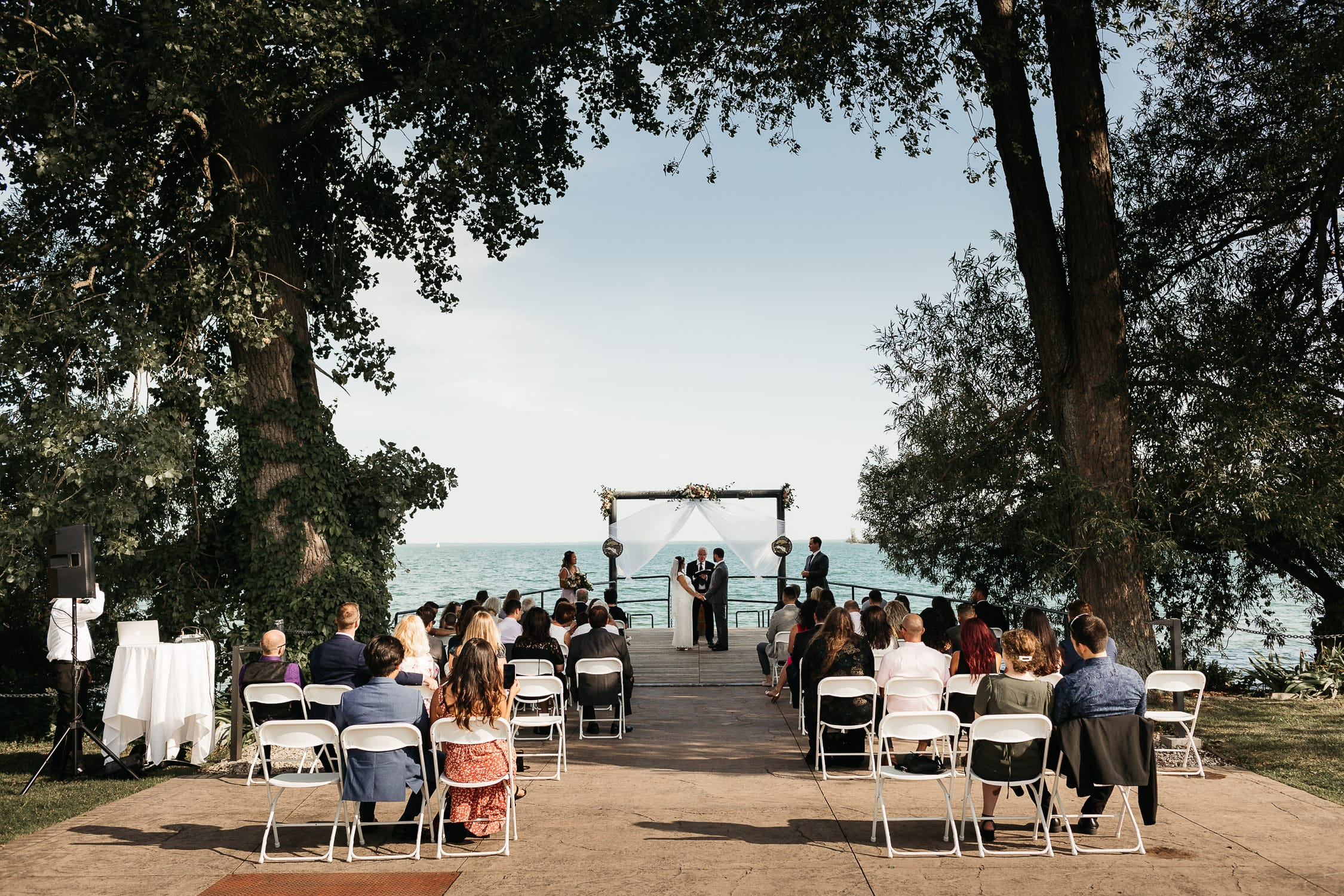 intimate wedding ceremony on dock at waupoos winery