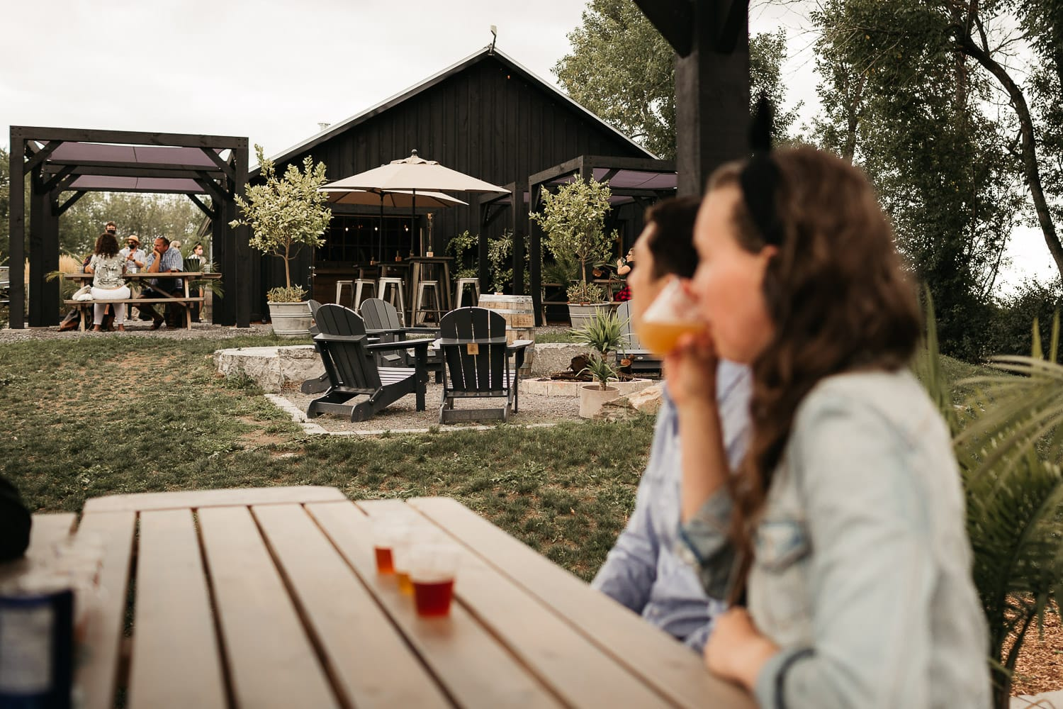 couple drinking craft beer in prince edward county