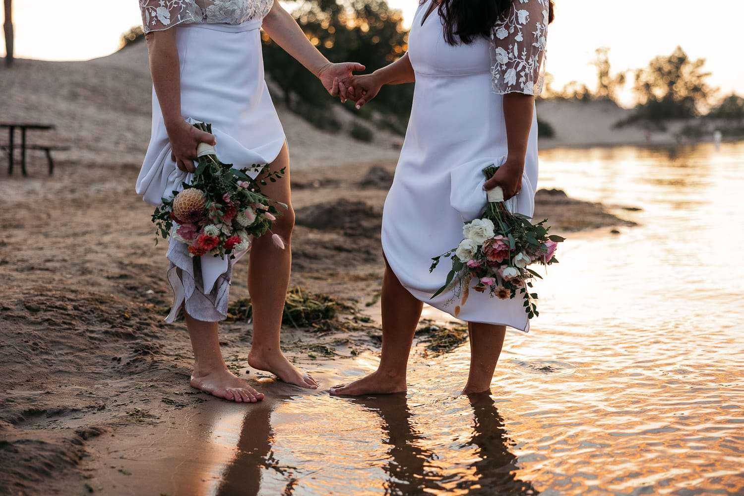 barefoot brides with bouquets at sandbanks dune beach